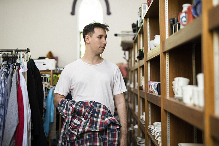man browsing clothes in an op shop